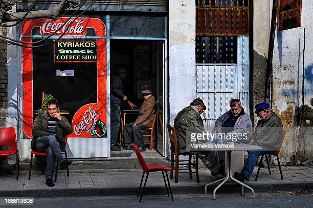 CONTENT] Men playing backgammon on the sidewalk and enjoying the afternoon sun outside a traditional coffee shop This street in the old part of...