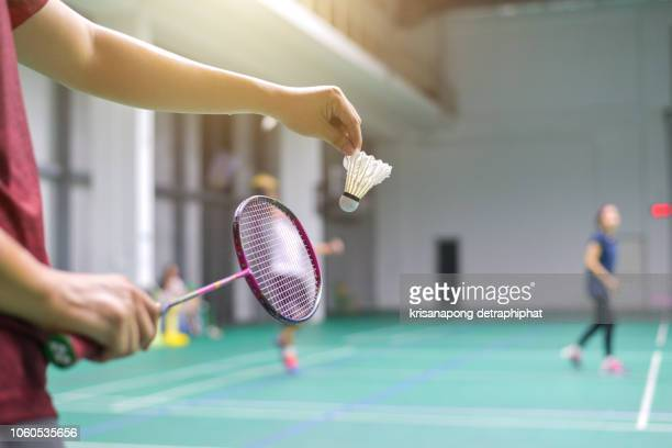 men playing badminton,exercise,badminton - badminton stock photos and pictures