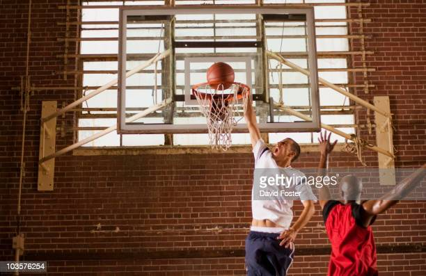 men playing basketball - shooting baskets stock photos and pictures