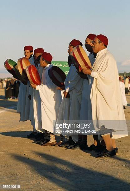 Men playing bendirs Festival of the Sahara in Douz Tunisia