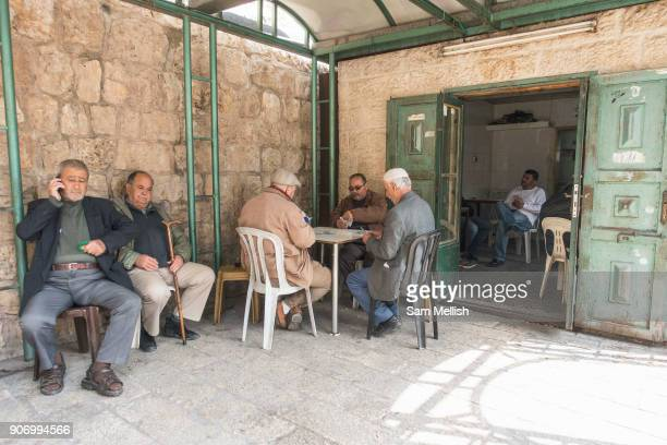 Men playing cards next to Herod's Gate in the Old City on 31st March 2016 in Jerusalem West Bank