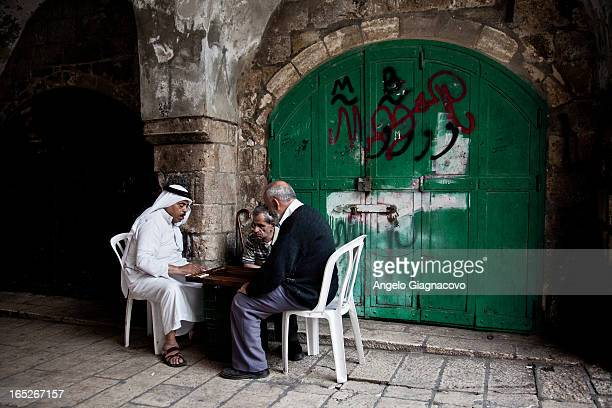 Men playing chess and checkers in the streets of Jerusalem, Israel.