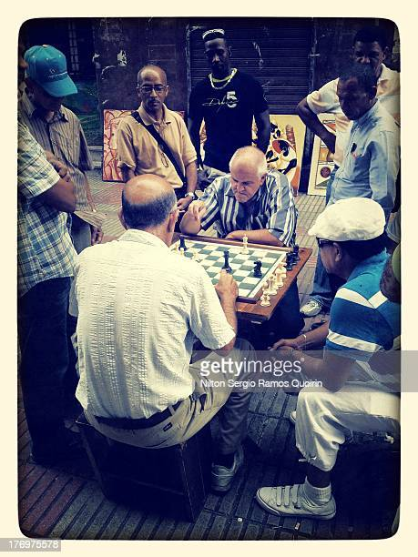 CONTENT] Men playing chess in El Conde pedestrian street in Santo Domingo colonial zone