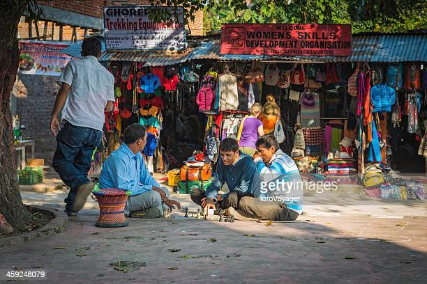 men playing chess under tree in pokhara nepal - pokhara stock pictures, royalty-free photos & images