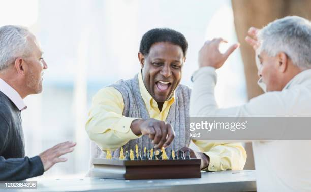 men playing chess, winning move - playing chess stock pictures, royalty-free photos & images