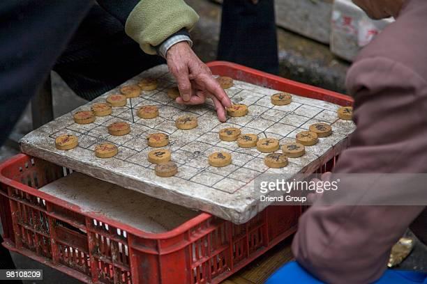 Men playing Chinese chess 'Xiangqi'.