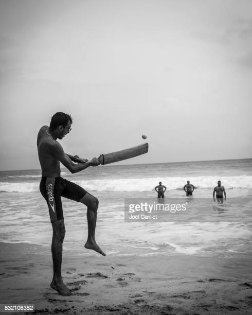 Men playing cricket at beach in Mirissa, Sri Lanka