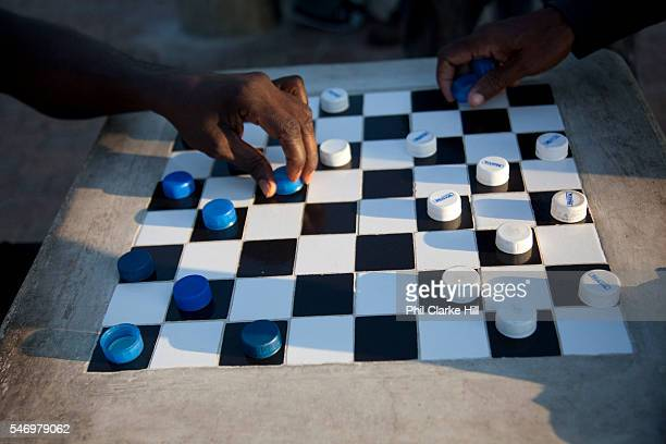 Men playing dominoes in the street Trenchtown Kingston Jamaica