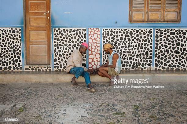 Men playing game on city street