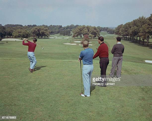 men playing golf at golf course - number of people stock pictures, royalty-free photos & images