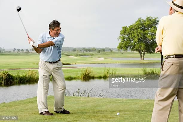 men playing golf - チノパンツ ストックフォトと画像