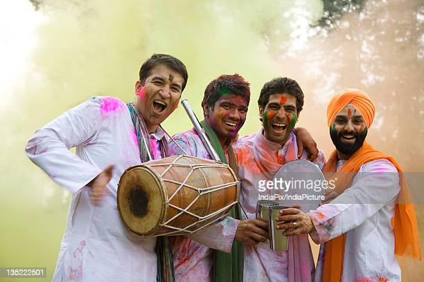 Men playing Holi