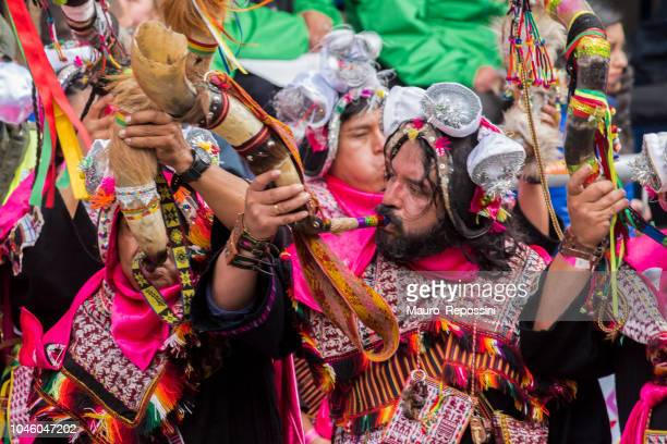 Men playing horns at Oruro Carnival in Bolivia.