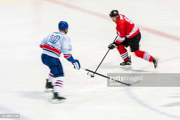 men playing ice hockey - ice hockey glove stock pictures, royalty-free photos & images