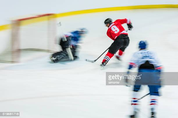 men playing ice hockey - ice hockey player stock pictures, royalty-free photos & images