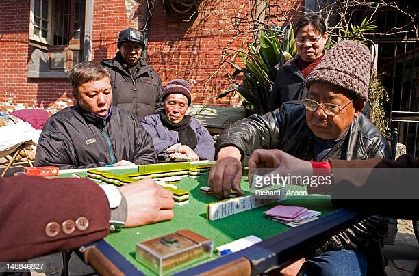 Men playing mahjong on Dongtai Road in Old Town.