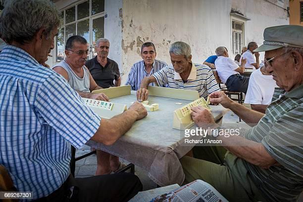Men playing Okey board game