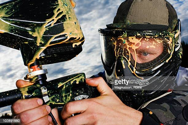 men playing paintball, sweden. - paintball foto e immagini stock