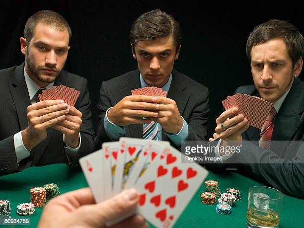 men playing poker - poker stock-fotos und bilder