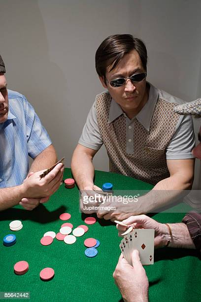 Men playing poker together