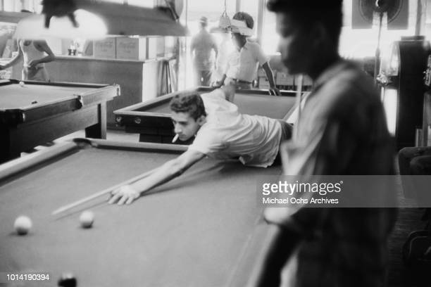 Men playing pool at a bar in Harlem New York City June 1957