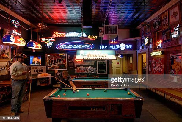 Men Playing Pool in Bar