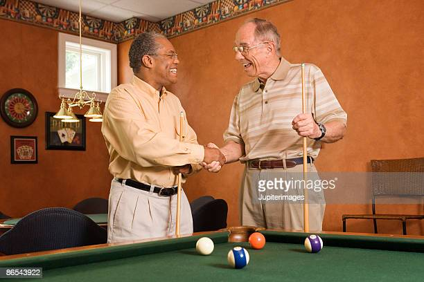 men playing pool shaking hands - old men playing pool stock pictures, royalty-free photos & images