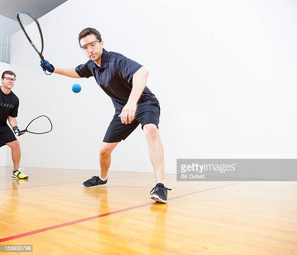 men playing racquetball - squash sport stock pictures, royalty-free photos & images