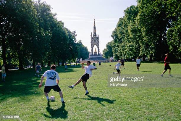 men playing soccer in hyde park - land stock pictures, royalty-free photos & images