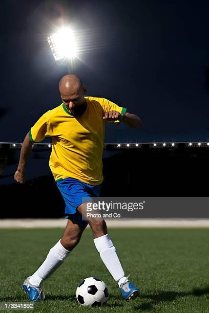 men playing soccer in stadium