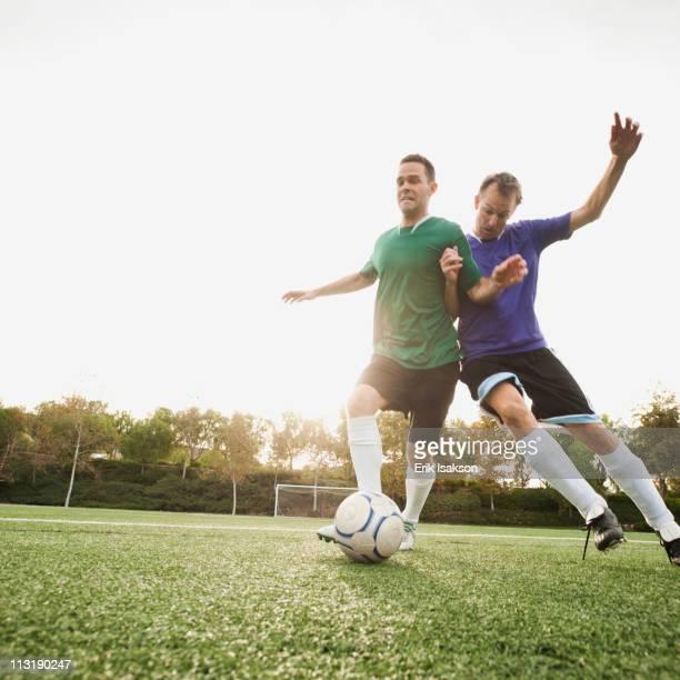 Men playing soccer on soccer field