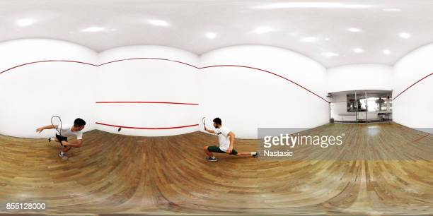 Men playing squash game