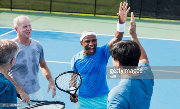 men playing tennis, high-five - doubles sports competition format stock pictures, royalty-free photos & images