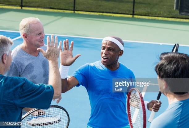 men playing tennis, high-five - doubles stock pictures, royalty-free photos & images