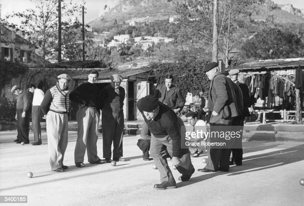 Men playing the French game of boules or petanque in Villefranchesur Mer Original Publication Picture Post 6195 Petanque unpub