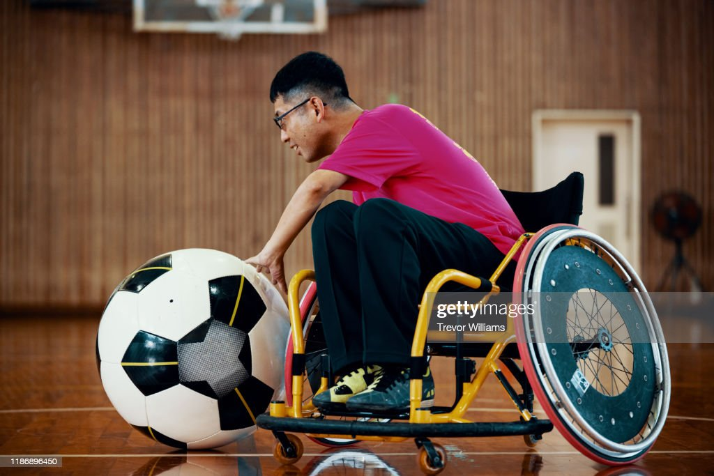 Men playing the inclusive sport of wheelchair soccer : ストックフォト
