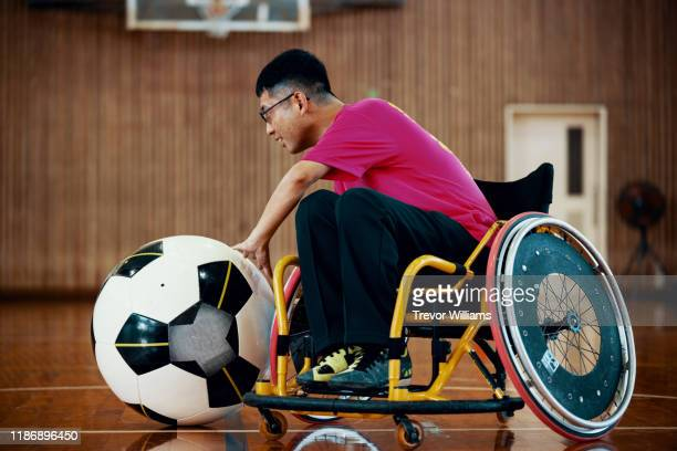 men playing the inclusive sport of wheelchair soccer - disabilitycollection stock pictures, royalty-free photos & images