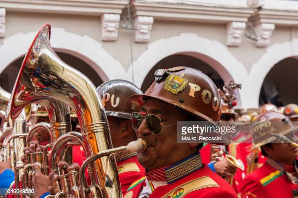 Men playing tubas at Oruro Carnival in Bolivia.