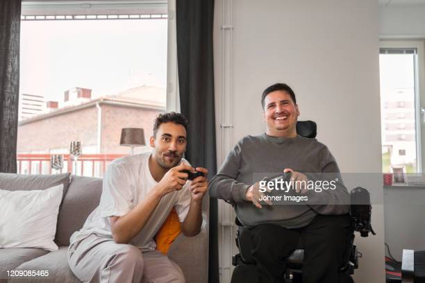 men playing video games - disability stock pictures, royalty-free photos & images
