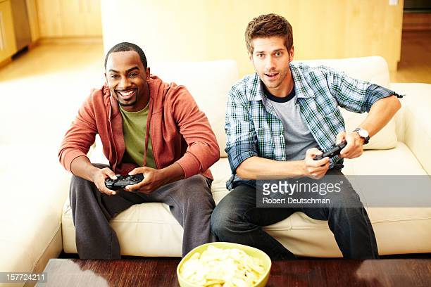 Men playing video games.