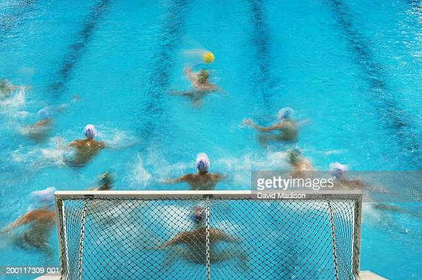 Men playing water polo, elevated view (blurred motion)