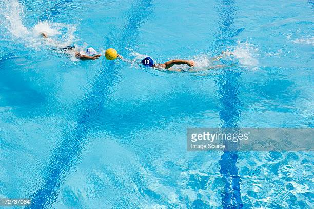 men playing water polo - water polo stock pictures, royalty-free photos & images