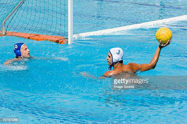 Men playing water polo
