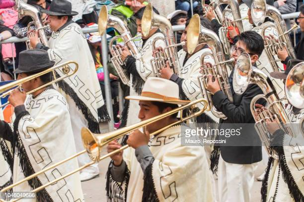 Men playing wind instruments at Oruro Carnival in Bolivia.