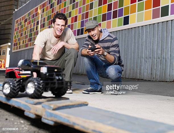 men playing with remote control car - remote control car games stock pictures, royalty-free photos & images