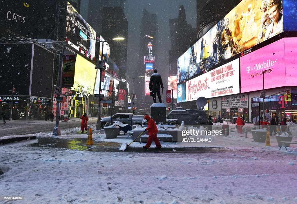Men plow snow in Times Square during a snowstorm in New York on March 14, 2017. Winter Storm Stella unleashed its fury on much of the northeastern United States on March 14 dropping snow and sleet across the region and leading to school closures and thousands of flight cancellations. Stella, the most powerful winter storm of the season, was forecast to dump up to two feet (60 centimeters) of snow in New York and whip the area with combined with winds of up to 60 miles per hour (95 kilometers per hour), causing treacherous whiteout conditions. But after daybreak the National Weather Service (NWS) revised down its predicted snow accumulation for the city of New York, saying that the storm had moved across the coast. PHOTO / Jewel SAMAD