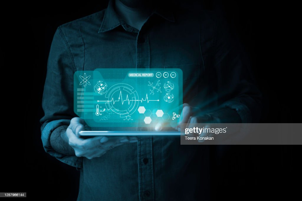 Men point to digital tablets with virtual screen icons and health examination reports. : Stock Photo