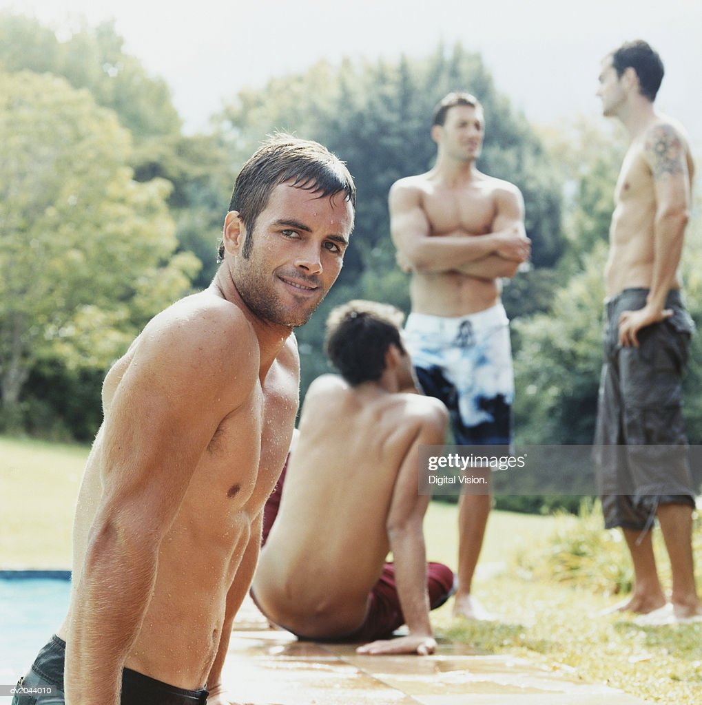 Men Poolside : Stock Photo