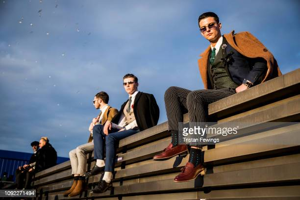 men pose for a photograph during the 95th Pitti Uomo at Fortezza Da Basso on January 10 2019 in Florence Italy