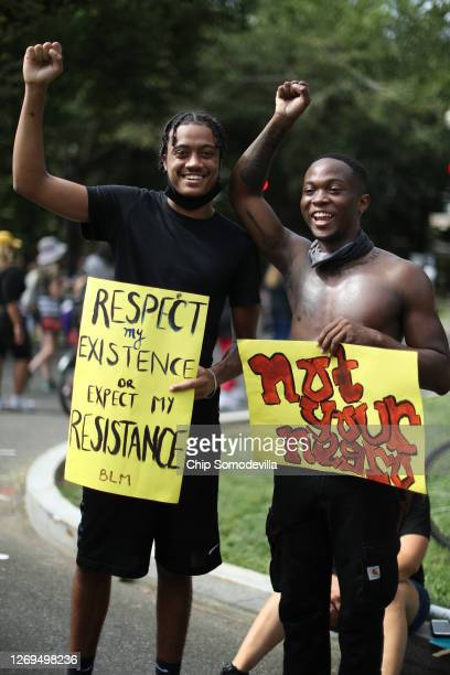 Men pose for a photograph while marching from the Lincoln Memorial to the Martin Luther King Jr. Memorial during the March on Washington August 28,...